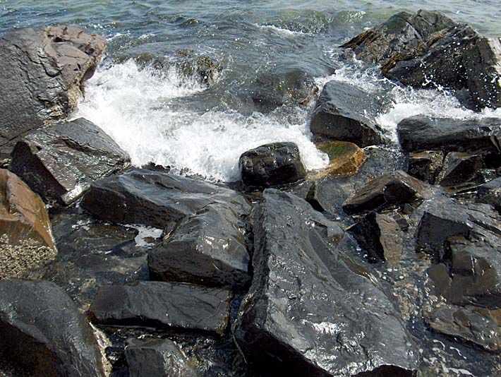 Brandie Newmon Ocean Waves Crashing into the Rocky Maine Coast stretched canvas art print