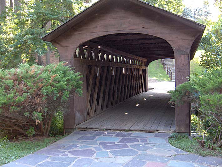 Brandie Newmon Covered Wooden Bridge stretched canvas art print