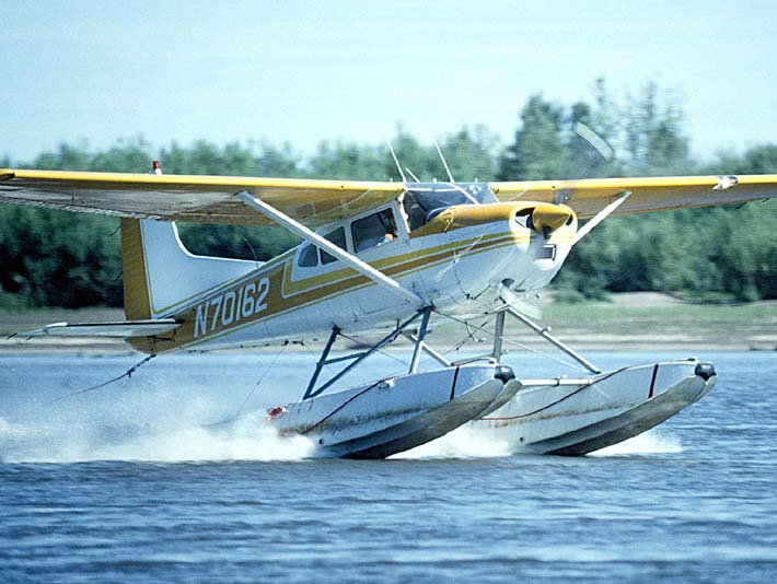 U S Fish and Wildlife Service Float Plane in Water stretched canvas art print