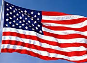 Visions of America American Flag Blowing in the Wind with a Blue Sky