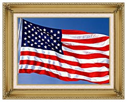 Visions of America American Flag Blowing In The Wind With A Blue Sky canvas with gallery gold wood frame