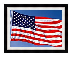 Visions of America American Flag Blowing In The Wind With A Blue Sky canvas with modern black frame